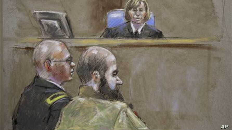 In this court room sketch, Judge Col. Tara Osborn, top, Maj. Nidal Malik Hasan, right, and defense attorney, Lt. Col. Kris Poppe, left, are shown, Wednesday, Aug. 21, 2013, in Fort Hood, Texas. Hasan rested his case Wednesday without calling any witn