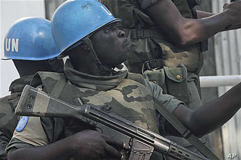 UN forces patrol on a street in Abidjan, Ivory Coast, after UN chief warns that Ivory Coast faces 'real risk' of return to civil war, Dec 22, 2010