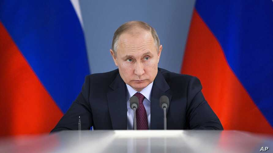 Russian President Vladimir Putin attends a meeting during his visit to Samara, Russia, March 7, 2018. Putin had more words of praise for U.S. President Donald Trump in a documentary released March 7 but expressed disappointment with the U.S. politica