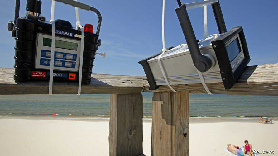 FILE - Air quality monitoring equipment is installed on the pier at the beach on Dauphin Island, Alabama, May 10, 2010, two days after tar balls washed up onshore.