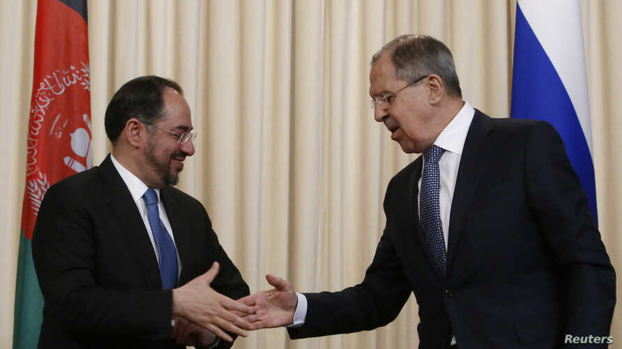 FILE - Russian Foreign Minister Sergei Lavrov and his Afghan counterpart, Salahuddin Rabbani, shake hands during a joint news conference following their meeting in Moscow, Feb. 7, 2017.