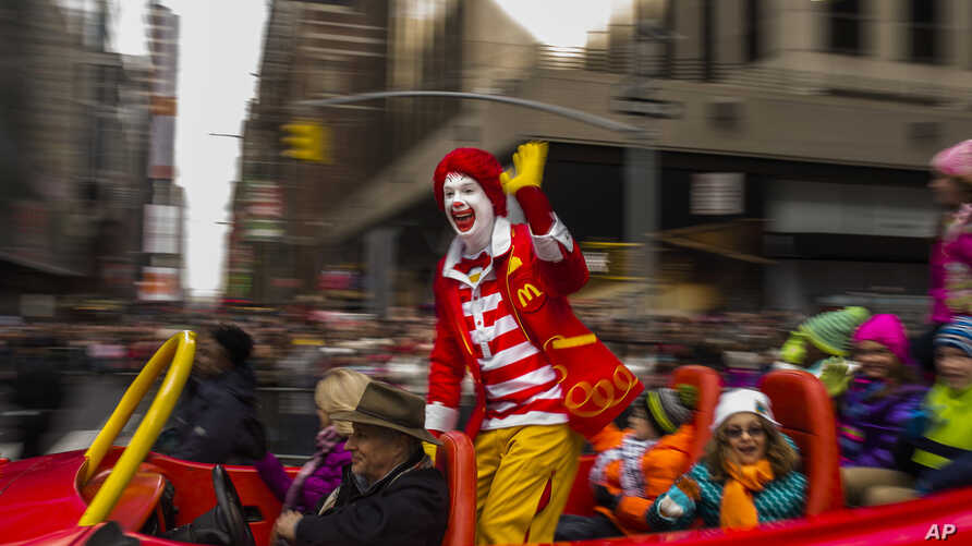 FILE - Ronald McDonald waves to the crowd during the Macy's Thanksgiving Day Parade, in New York, on November 26, 2015. McDonald's says Ronald McDonald is keeping a low profile with reports of creepy clown sightings on the rise.