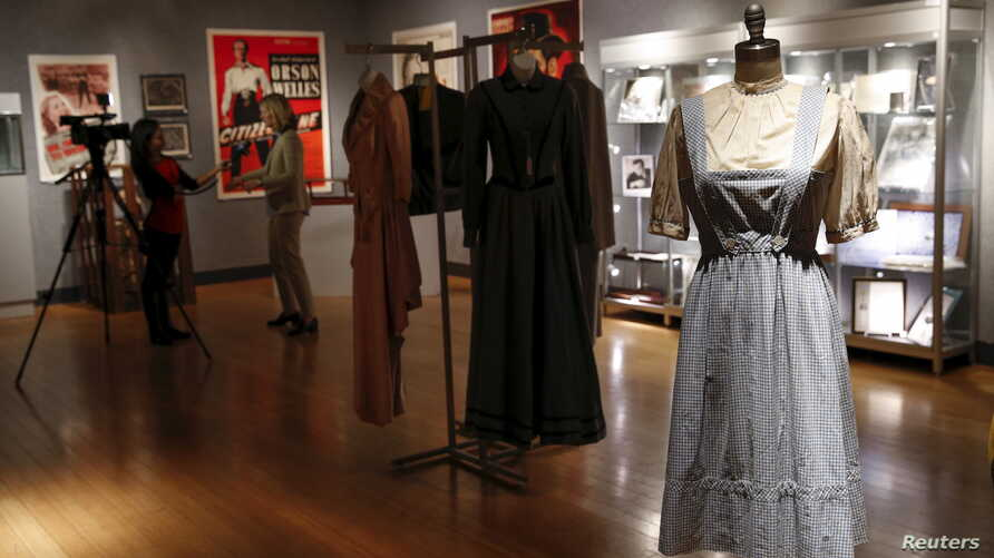 """The """"Dorothy"""" dress warn by Judy Garland in The Wizard of Oz is seen during a media preview of Bonhams and Turner Classic Movies Treasures from the Dream Factory at Bonhams in New York, Nov. 19, 2015."""