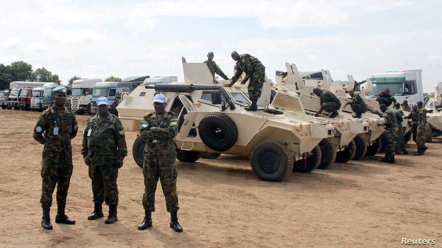Rwandan peacekeepers from the Rwanda Defence Force (RDF) check their armored personnel carriers (APC) before a parade in Juba, South Sudan, August 8, 2017.