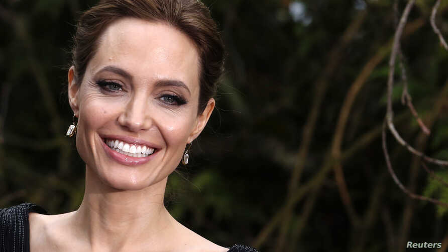 Actress Angelina Jolie arrives for a special Maleficent Costume Display at Kensington Palace in London, May 8, 2014.