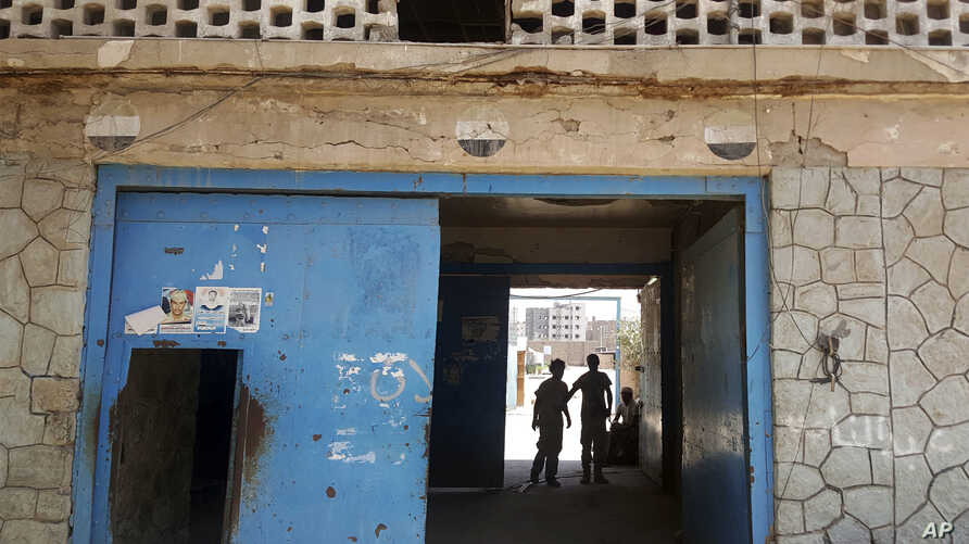 The entrance of Aden Central Prison, known as Mansoura, where one wing is run by Yemeni allies of the United Arab Emirates to detain al-Qaida suspects, is shown in this May 9, 2017 photo in Aden, Yemen. Hundreds detained in the hunt for militants hav