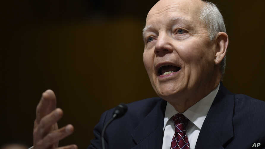 "FILE - Commissioner John Koskinen says it's believed that those responsible for the theft of information from the Internal Revenue Service are ""not amateurs."""