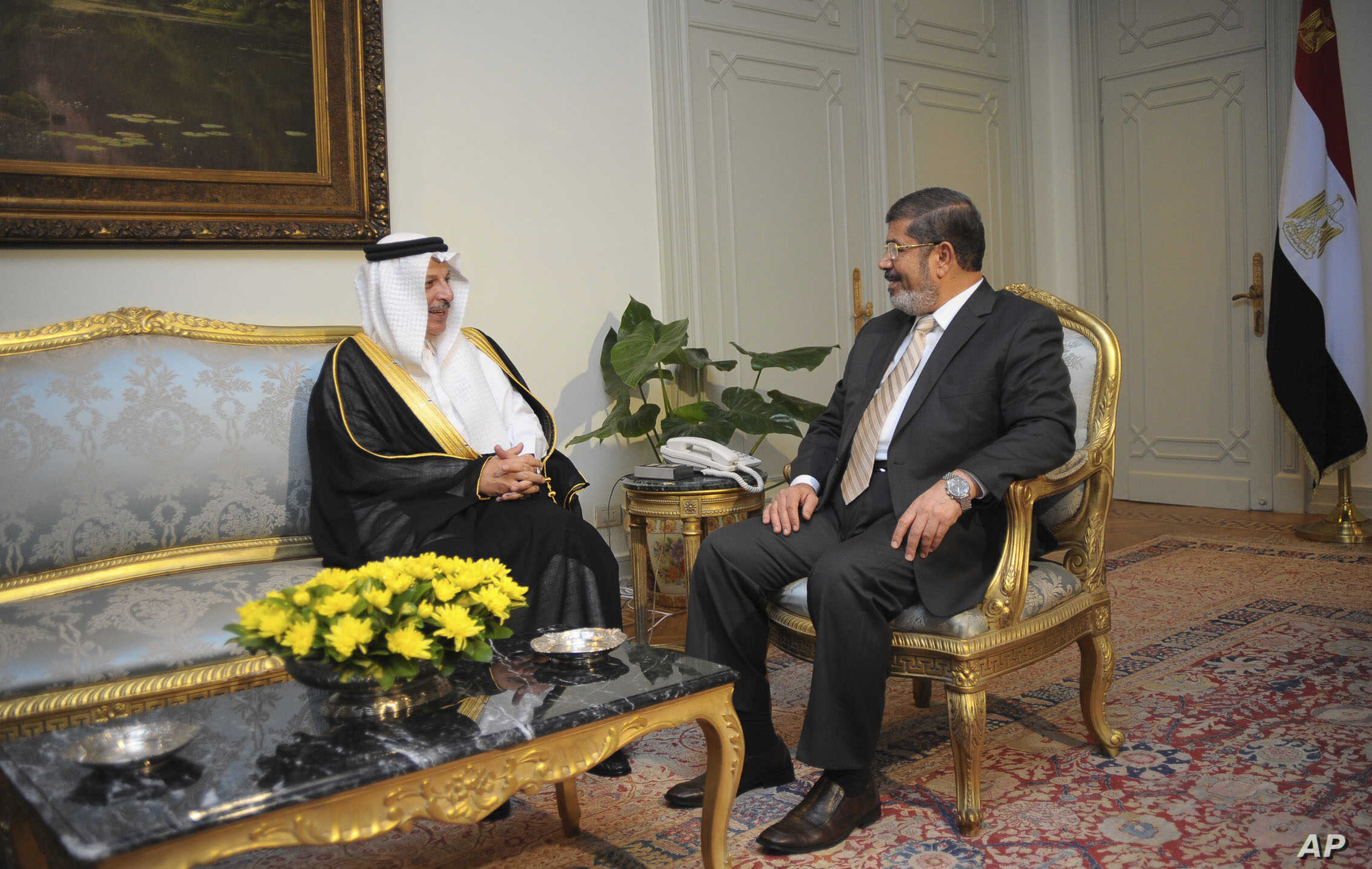 In this photo released by the Egyptian Presidency, Saudi Arabia's ambassador to Egypt Ahmed Kattan meets with Egyptian President Mohammed Morsi, in Cairo, July 7, 2012.