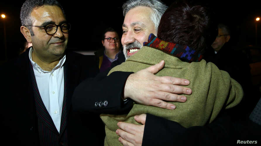 Murat Sabuncu, editor-in-chief of the newspaper Cumhuriyet, is greeted by his friends after being released from the prison in Silivri near Istanbul, Turkey, March 10, 2018