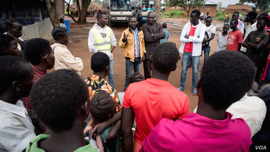A Ugandan government official briefs newly arrived refugees on the laws of Uganda.