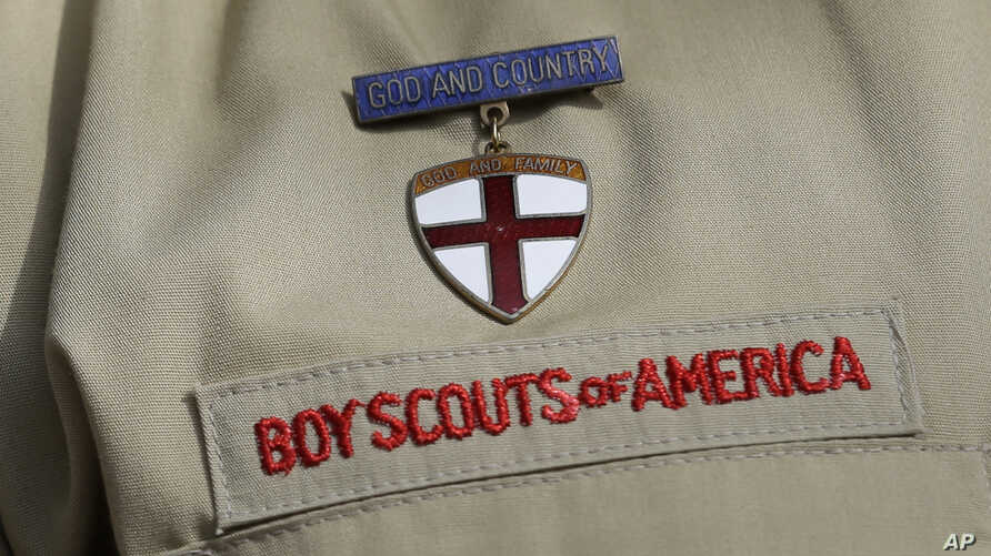 FILE - A detail of a Boy Scout uniform in front of the Boy Scouts of America headquarters in Irving, Texas, Feb. 4, 2013.