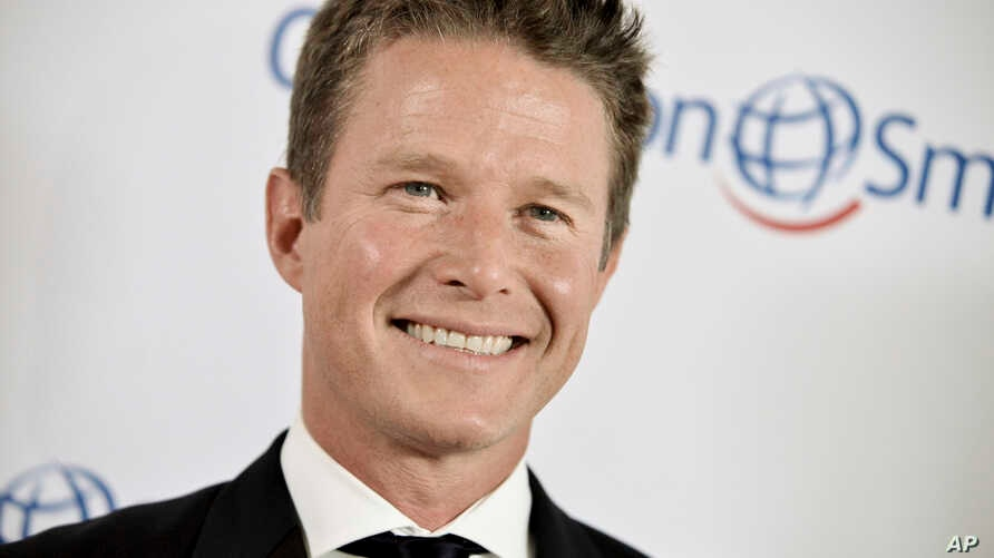 FILE - Billy Bush arrives at the Operation Smile's 2014 Smile Gala in Beverly Hills, Calif.
