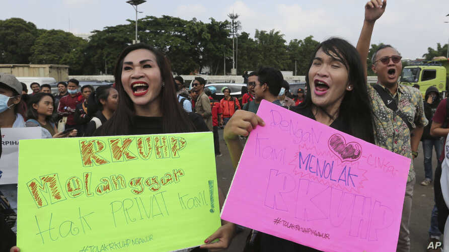 LGBT activists shout slogans during a rally against a planned revision to Indonesia's criminal code, outside the Parliament in Jakarta, Indonesia, Monday, Feb. 12, 2018.