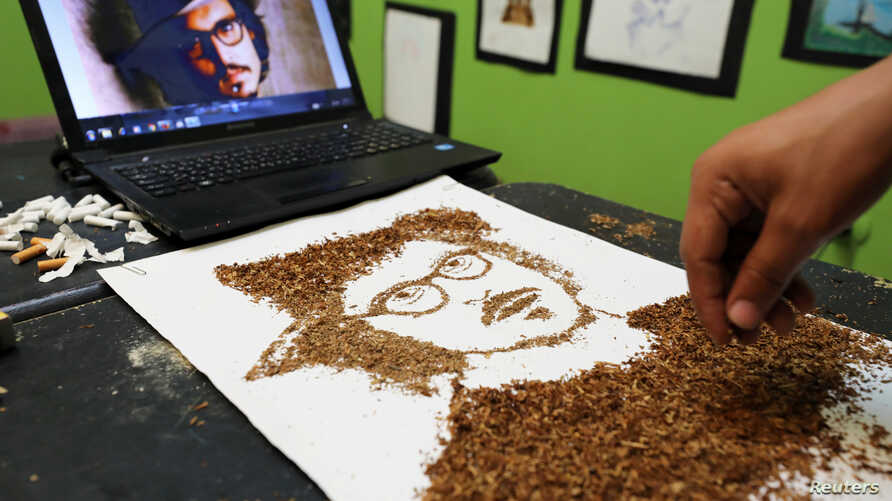 Artist Abdelrahman al-Habrouk creates a portrait of the actor Johnny Depp with tobacco in Alexandria, Egypt August 10, 2017.