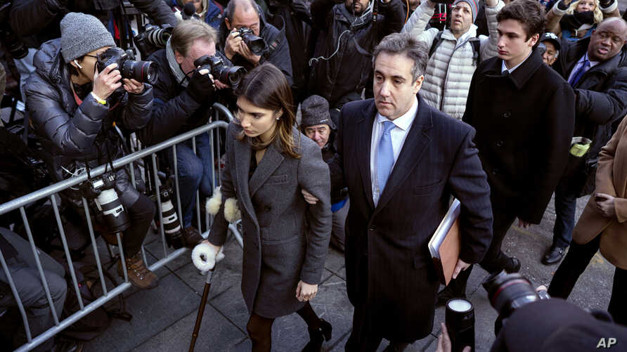 Michael Cohen, center, President Donald Trump's former lawyer, accompanied by his children Samantha, left, and Jake, right, arrives at federal court for his sentencing in New York, Dec. 12, 2018.