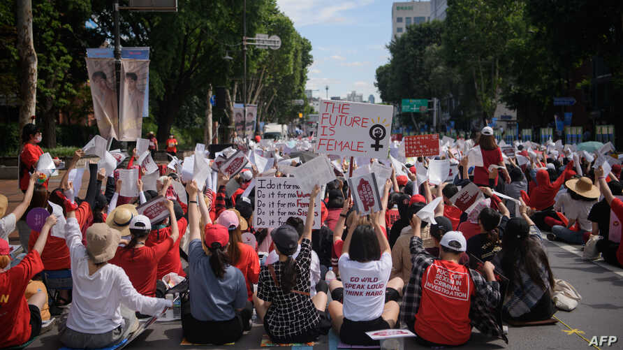 Female protesters call for South Korea's government to crack down on widespread spycam porn crimes during a rally in Seoul on July 7, 2018.