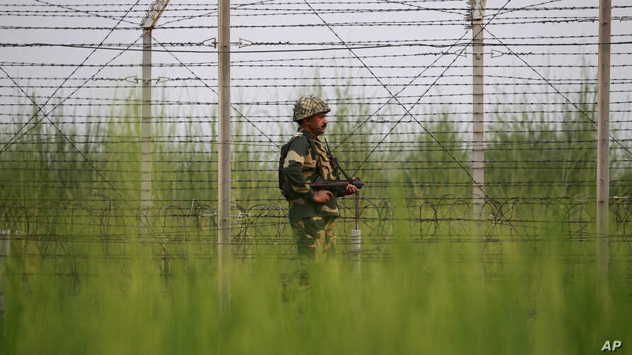An Indian Border Security Force soldier patrols near the India-Pakistan international border area at Gakhrial boder post in Akhnoor sector, about 48 kilometers from Jammu, India, Oct. 1, 2016.