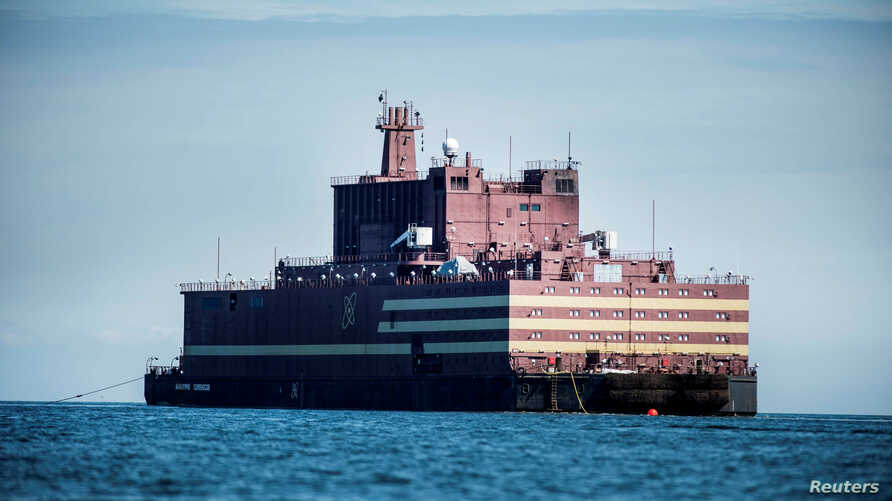 """The Russian """"Academy Lomonosov,"""" the world's first floating nuclear power plant, passes Langeland island, while heading for Murmansk in northwestern Russia, May 4, 2018. China plans to power some of its claimed islets in the South China Sea with flo"""