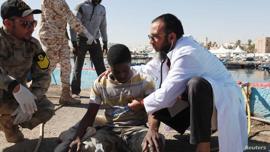 Migrants receive medical treatment in a port, after being rescued at sea by Libyan coast guard, in Tripoli, Libya, April 11, 2016.