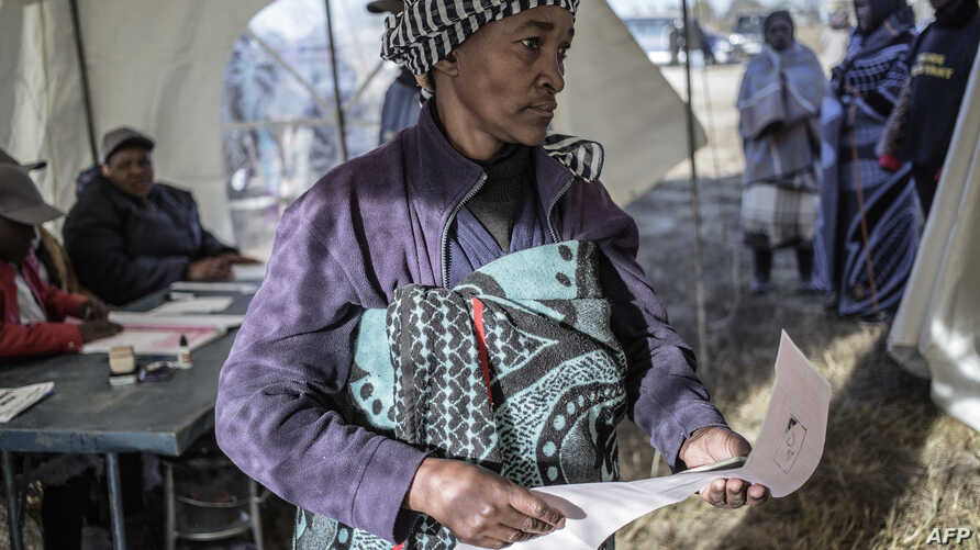 A Basotho woman prepares to cast her ballot, at a polling station on June 3, 2017 in Maseru, during Lesotho's general election.