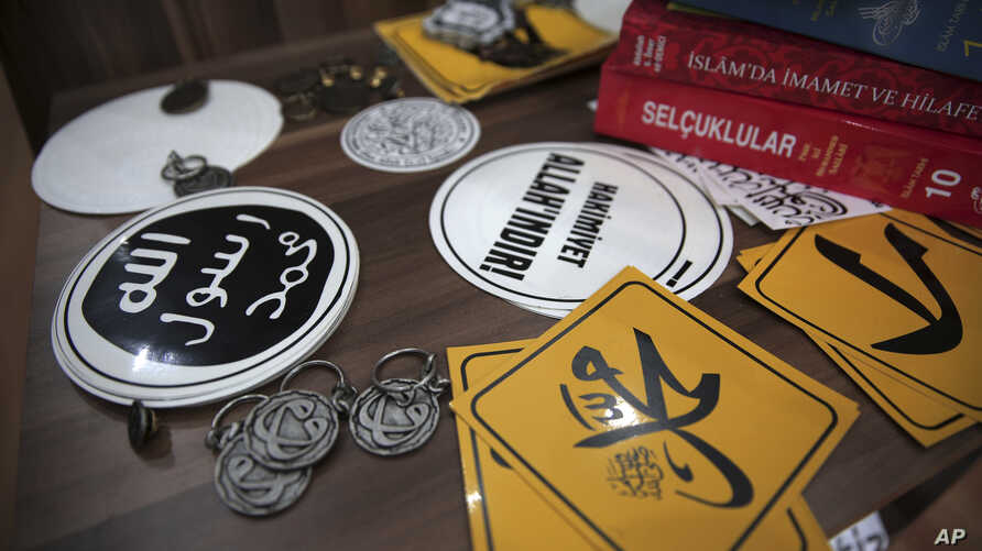 FILE - In this Oct. 13, 2014, photo, Islamic State group pins and stickers are on display at an Islamic bookstore in the Fatih district of Istanbul, Turkey.