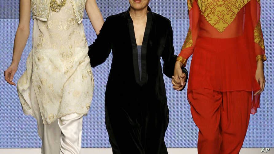 FILE - Pakistani designer Maheen Khan takes the catwalk during a fashion show in Milan, Italy, Sept. 30, 2009.