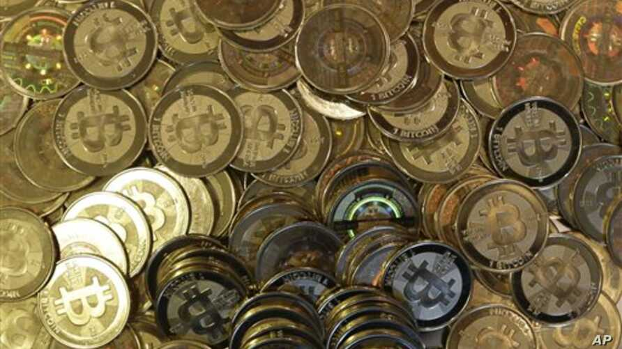 A pile of bitcoin tokens - a retro-futuristic kind of prepaid currency that made its debut four years ago - are shown, April 2013.