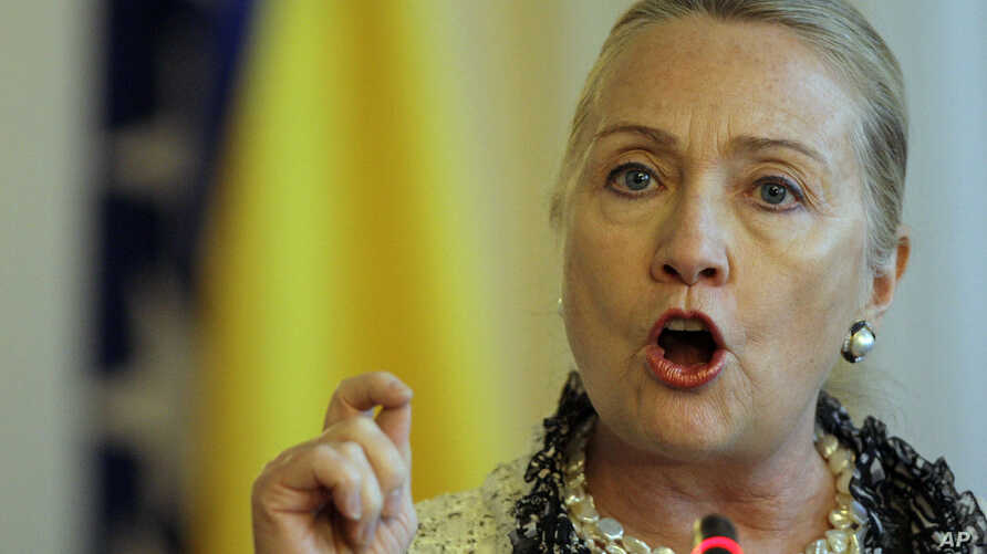 US Secretary of State Hillary Rodham Clinton gestures as she addresses journalists after meeting with the High Representative for EU Foreign Policy Catherine Ashton and members of the Bosnian Tri Partite Presidency, at the Presidency in Sarajevo, Bos