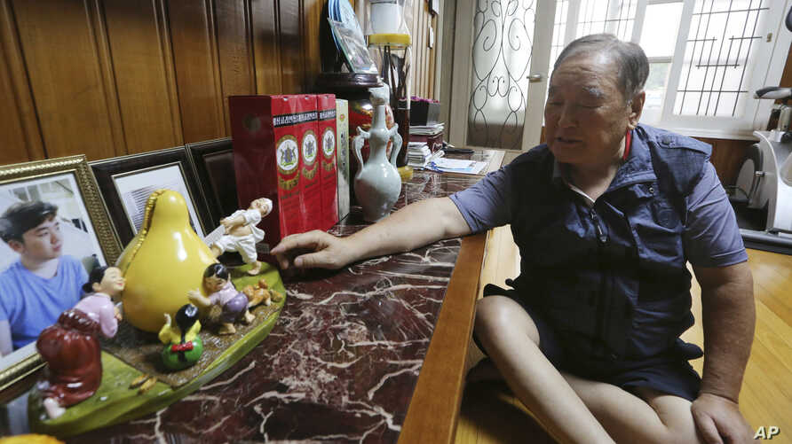 In this Aug. 23, 2018, photo, Ham Sung-chan, 93, watches gifts he received from his North Koran brother Ham Dong Chan during an interview at his house in Dongducheon, South Korea. After nearly 70 years of a separation forced by a devastating 1950-53