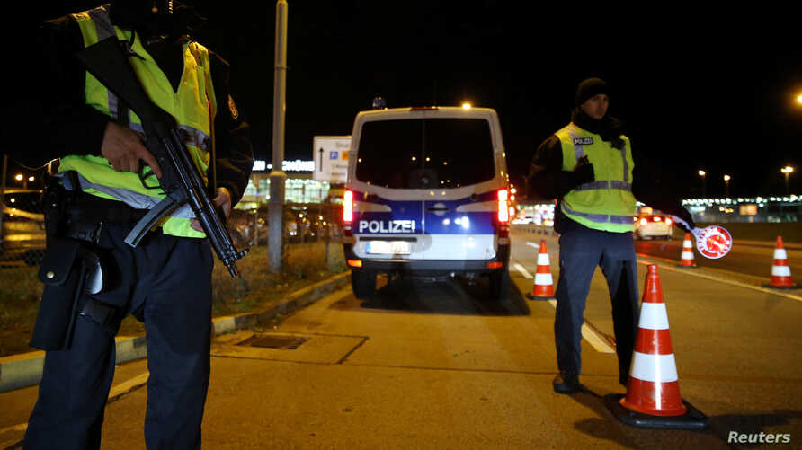German police are seen at a checkpoint to enter Berlin-Schoenefeld airport, in Schoenefeld, following a suspicion that a bomb attack was being planned in Germany, October 8, 2016.