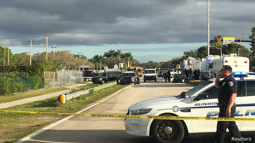 Police patrol the area outside Marjory Stoneman Douglas High School following a school shooting incident in Parkland, Florida,  Feb. 15, 2018.