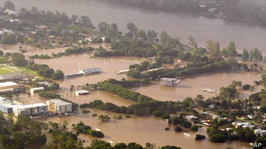 Flood waters inundate a suburb on the Brisbane River, 12 Jan 2011