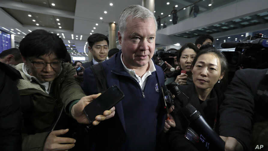 U.S. Special Representative for North Korea Stephen Biegun, center, is questioned by reporters upon his arrival at Incheon International Airport in Incheon, South Korea, Feb. 3, 2019.