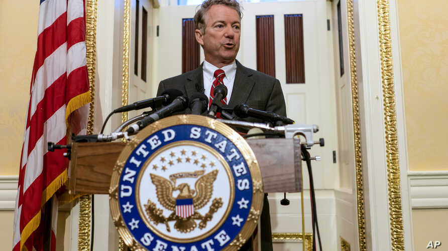 FILE - Sen. Rand Paul, R-Ky., answers reporters' questions during a news conference on Capitol Hill in Washington.