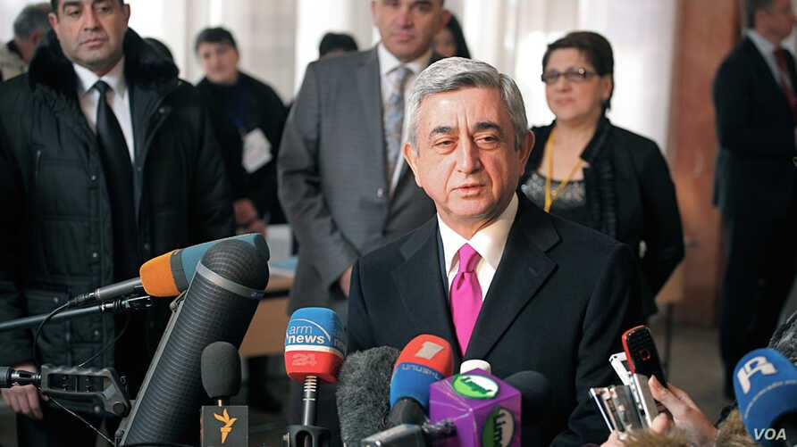 Armenia's President Serzh Sargsyan talks to reporters after casting his paper ballot at a voting station in Yerevan. A Gallup exit poll showed that he had won reelection for a second, five year term running the former Soviet Republic. (Vera Undritz f