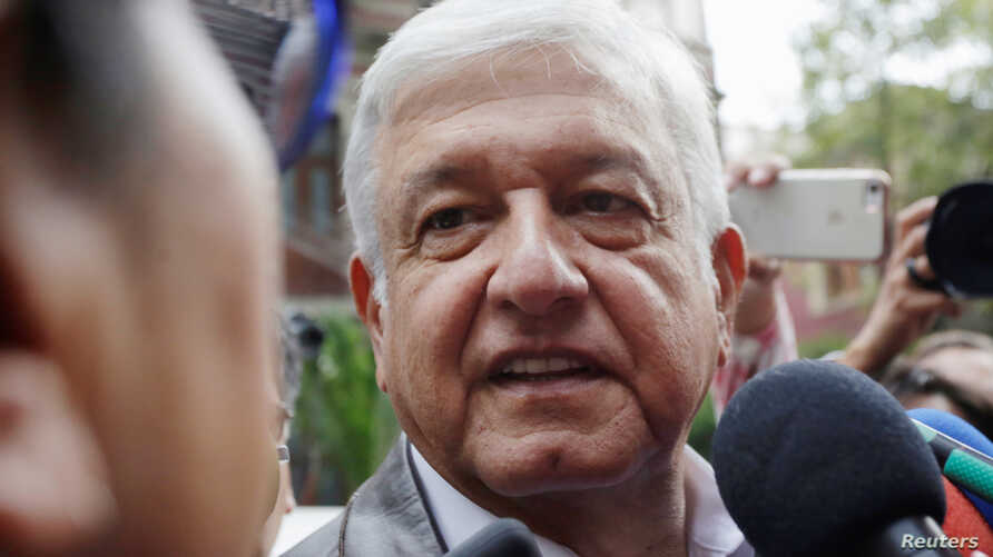 Mexican President-elect Andres Manuel Lopez Obrador talks to a journalist as he arrives for a meeting with his new cabinet in Mexico City, July 7, 2018.