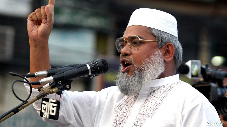 FILE - Bangladesh Minister for Social Welfare Ali Ahsan Mojaheed addresses a protest rally organized by the Jamat -e-Islami Party in Dhaka, April 21, 2006.