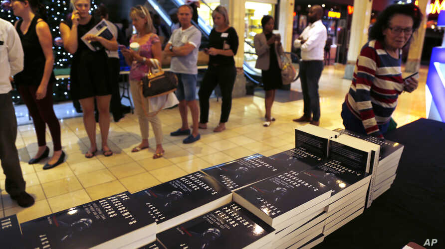 People queue to buy the newly published book by investigative journalist Jacques Pauw, at the launch of The President's Keepers, in Johannesburg, Nov. 8, 2017.