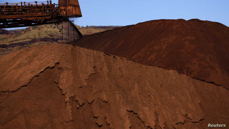 Major mining companies like Rio Tinto, unloading iron ore in Australiaa in December, 2013, will learn the true extent of Cameroon's resources after a World Bank-funded aerial survey of one of Africa's mineral-rich nation's.