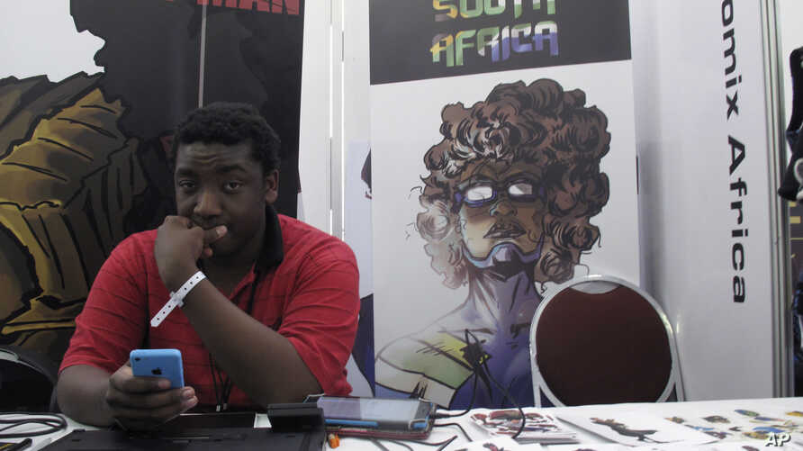 "Bill Masuku, a Zimbabwean comic book artist and writer, sits at a stall at Comic Con Africa, a three-day comic book and pop culture convention in Johannesburg, South Africa, Sept. 15, 2018. The success of Marvel's ""Black Panther"" film spiked interest"