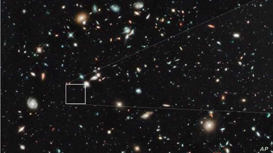 The farthest and one of the very earliest galaxies ever seen in the universe appears as a faint red blob in this ultra-deep–field exposure taken with NASA's Hubble Space Telescope