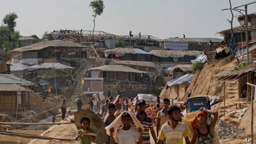 Rohingya refugees rebuild their makeshift houses, in preparation for the approaching monsoon season at the Kutupalong Rohingya refugee camp in Kutupalong, Bangladesh, April 28, 2018.