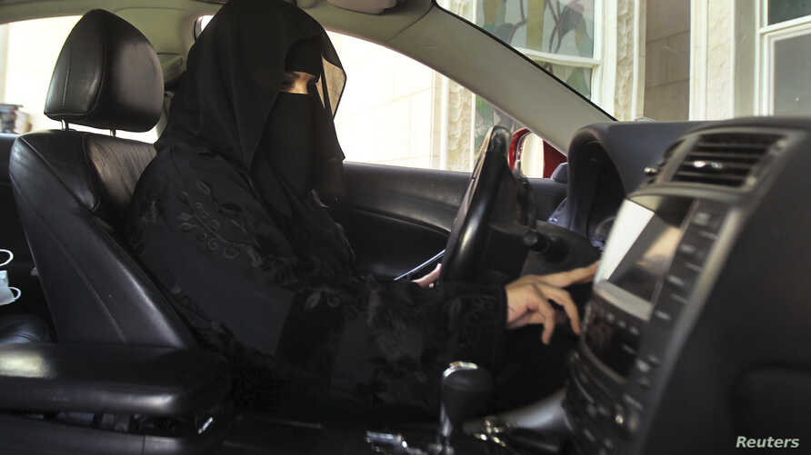 A woman drives a car in Saudi Arabia, Oct. 22, 2013.