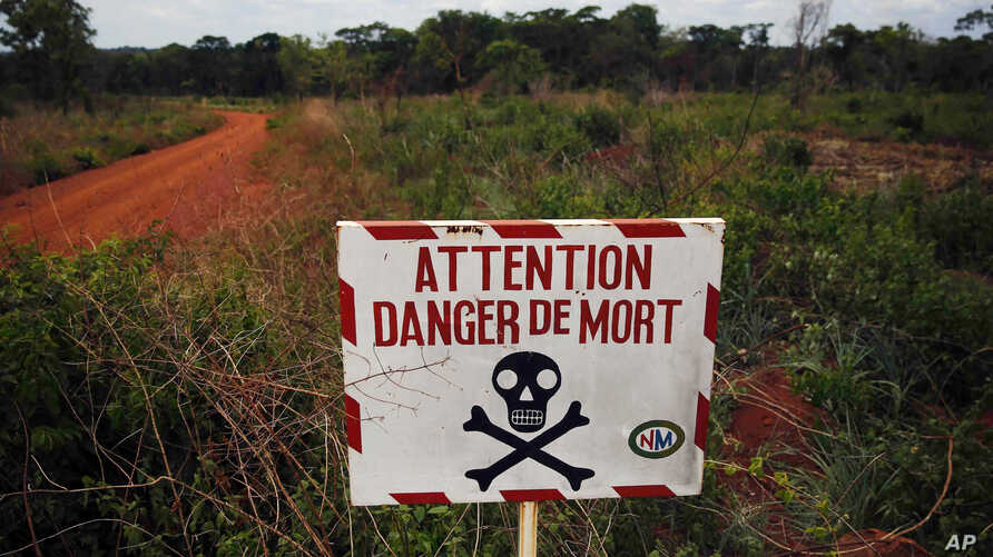 FILE - In this April 11, 2014 picture, a sign warns travelers of the dangers ahead on the road to Bambari, Central African Republic. According to a Human Rights Watch report released Tuesday, May 2, 2017, armed groups targeting civilians have killed
