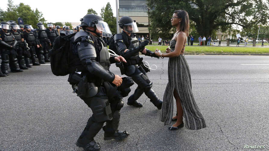 Protestor Ieshia Evans is detained by law enforcement near the headquarters of the Baton Rouge Police Department in Baton Rouge, Louisiana, July 9, 2016.