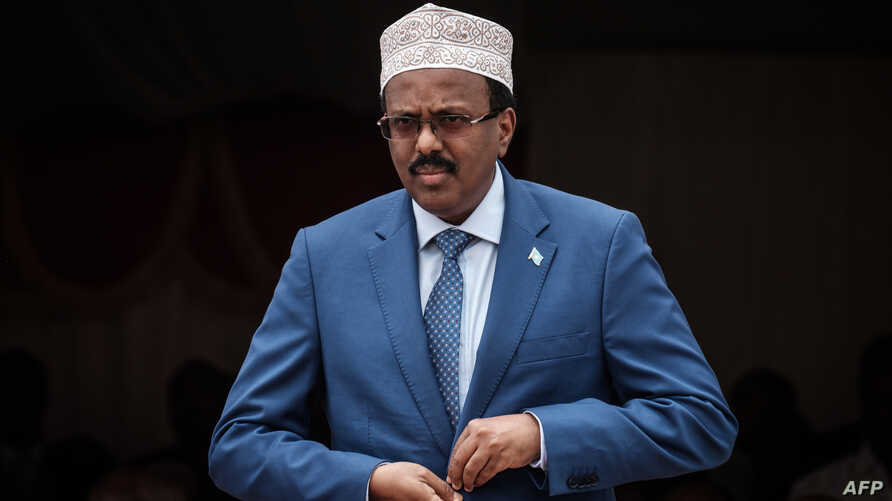 Somalia's President Mohamed Abdullahi Farmajo walks to make his speech during the inauguration ceremony of Djibouti International Free Trade Zone in Djibouti on July 5, 2018.