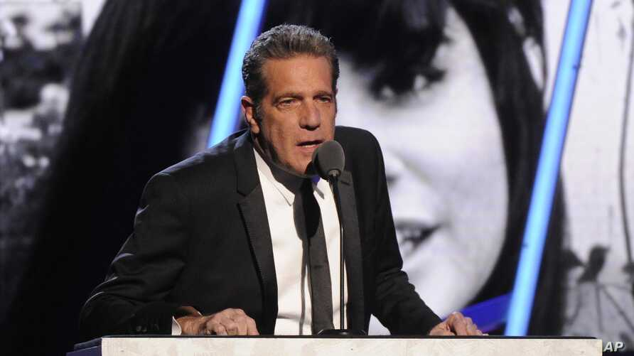 FILE - Glenn Frey speaks at the 2014 Rock and Roll Hall of Fame Induction Ceremony in New York, April, 10, 2014.
