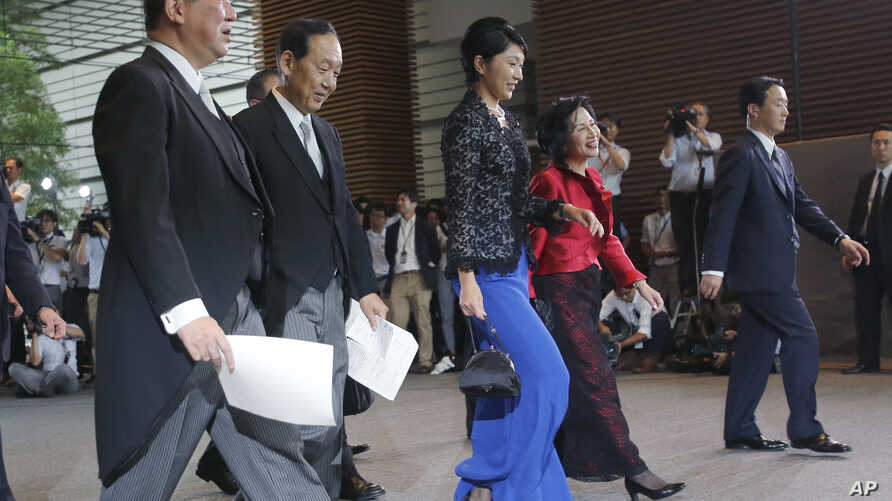 Newly appointed ministers leave the prime minister's office for the Impeiral Palace for the attestation ceremony in Tokyo, Wednesday, Sept. 3, 2014. New ministers are from left.,Minister in charge of regional issues, Shigeru Ishiba, left, Minister of