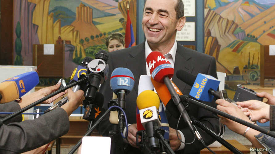 FILE - Armenia's President Robert Kocharyan speaks to the media after casting his ballot during a parliamentary election in Yerevan, May 12, 2007.