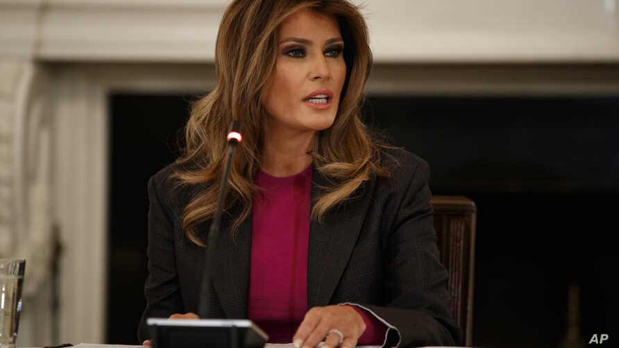 First lady Melania Trump speaks during a roundtable on cyberbullying in the State Dining Room of the White House, March 20, 2018, in Washington.